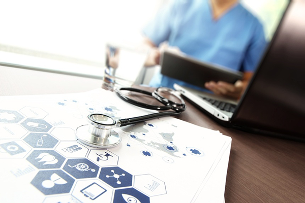 Doctor working with  laptop computer in medical workspace office and medical network media diagram as concept