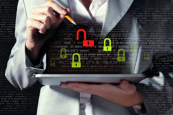 Businesswoman holding tablet pc entering password. Security concept-2